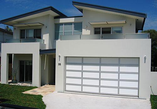 Garage door weatherboards adept garage doors and gates for Weatherboard garage designs